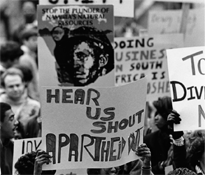 Students hold signs during an anti-apartheid demonstration in the quadrangle, 1985.